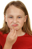 Young girl taking a pill Royalty Free Stock Photo