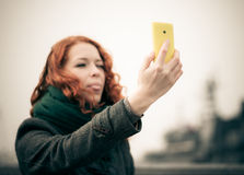 Young girl taking a selfie. Royalty Free Stock Photos
