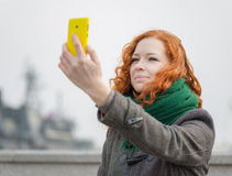 Young girl taking a selfie. Royalty Free Stock Photo