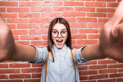 Young girl taking selfie smart phone/photo camera. Stock Image