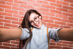 Young girl taking selfie smart phone/photo camera. Stock Images