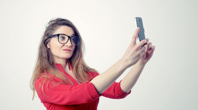 Young girl taking selfies with her smart phone Stock Image