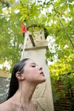 A young girl is taking a shower outdoors royalty free stock photography