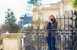Young girl taking a street photo in Paris Stock Photo