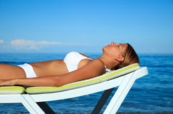 Young girl is taking a sun bath Royalty Free Stock Image