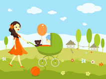 Young girl taking a walk with a baby in a pram Stock Photography