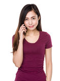 Young girl talk to cellphone Stock Images