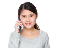 Young girl talk to mobile phone Royalty Free Stock Images