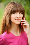 Young girl talking at the cell Royalty Free Stock Images