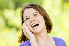 Young girl talking at the cell phone Royalty Free Stock Image