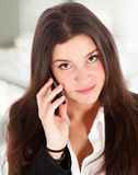 Young girl talking at cellphone Royalty Free Stock Photo