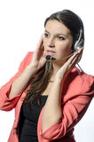 A young girl talking with headphones and microphone. The young girl talking with headphones and microphone royalty free stock image