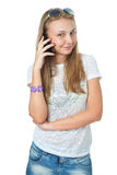 The young girl talking by a mobile phone Stock Images