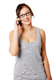 Young girl talking by mobile phone Stock Image