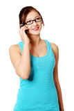 Young girl talking by mobile phone Royalty Free Stock Images