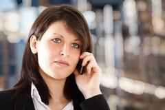 Young girl talking at phone stock image