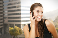 Young girl talking on the phone. Young attractive woman smiling while talking on the phone Stock Photo