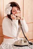 Young girl talking on the phone Stock Photo