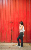 Young girl talking on the phone in the city. Young urban girl talking on the phone in the city Royalty Free Stock Image