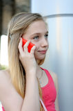 Young girl talking on the phone outdoor Stock Photography
