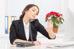 Young girl talking on phone at work. Stock Photos