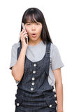 Young girl talking on smart phone over white Royalty Free Stock Photography