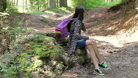 Young girl talking on smartphone in forest stock video footage