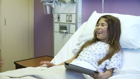 Young Girl Talking To Female Nurse In Hospital Room stock footage