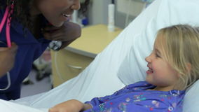 Young Girl Talking To Female Nurse In Intensive Care Unit stock footage
