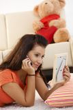 Young girl talking to her love on mobile Stock Images