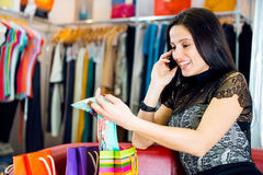 Young girl talking via phone in store Stock Photo