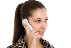 Young girl talks by white phone Stock Photos