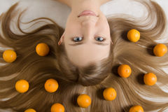 Young girl tangerine orange stock images