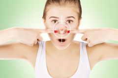 Young girl with target on her acne Stock Photo