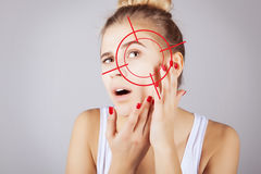 Young girl with target on her acne Stock Image