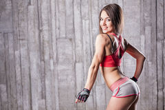 Young girl with taut buttocks. At the gym Royalty Free Stock Image