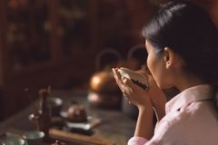 Young girl at a tea ceremony Stock Images