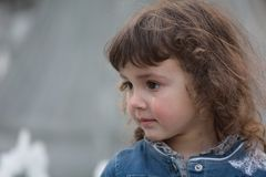 Young girl with tear running down cheek Stock Photo