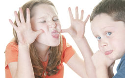 Young girl teasing boy Royalty Free Stock Photography