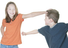 Young girl teasing boy Royalty Free Stock Images