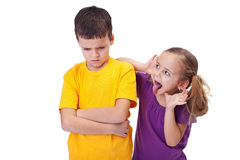 Young girl teasing and mocking a boy Stock Photos