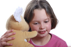 Young girl and teddy bear Royalty Free Stock Photos