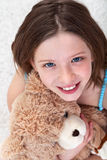 Young girl with teddy bear Stock Images