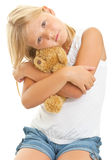 Young girl with teddy bear. Isolated on white background stock image