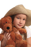 Young girl and teddy bear. Young girl wearing a straw hat with teddy bear Stock Images