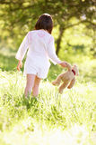Young Girl With Teddy Bear In Summer Field Royalty Free Stock Images
