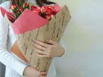 Young girl, teen girl holding bouquet of pink, red roses. Stock Photos