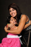 Young Girl and Teenager Embracing Royalty Free Stock Photo