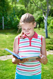 Young girl teenager reading books outdoors Royalty Free Stock Photography