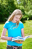 Young girl teenager reading books outdoors Stock Images